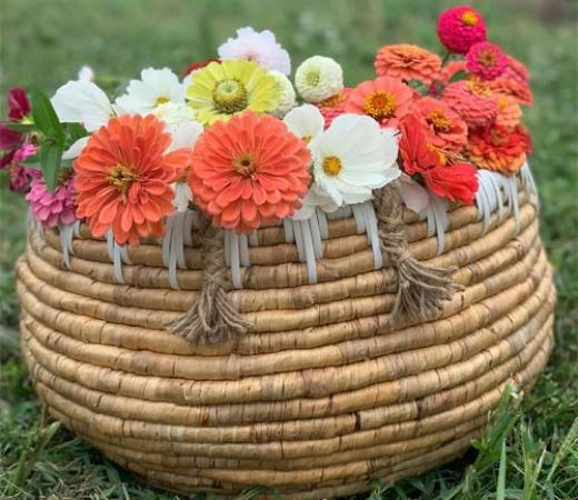 a bamboo basket filled with Zinnia flowers